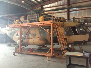 An Mi-17 undergoing maintenance. Most maintenance within SMW is carried out by contractors because SMW lacks the expertise. (SIGAR photo).