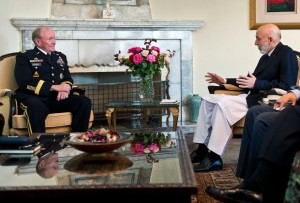 Dempsey and Karzai pose for the cameras while their countries come no closer to an agreement keeping US troops in Afghanistan. (Defense Department photo)