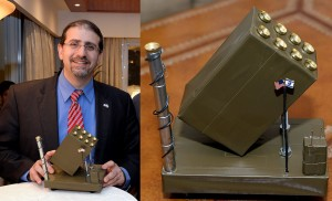 Ambassador Daniel Shapiro proudly displays the disgusting menorah in the shape of an Iron Dome missile battery, complete with tiny flags from the US and Israel.
