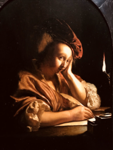 Woman writing a letter.